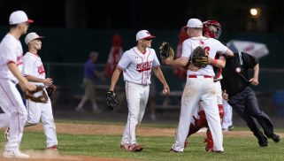 Wolcott players celebrate their win over Woodland in the Class M semifinals Tuesday at Muzzy Field in Bristol. Jim Shannon Republican American
