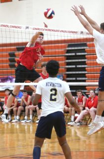 Cheshire High School's Colby Hayes sends the ball over the net as Cheshire battles Newington High School for the Class M boys volleyball title at Shelton High School on Thursday, June 6, 2019. Emily J. Reynolds. Republican-American
