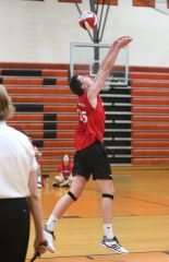 Cheshire High School's Colby Hayes bumps the ball back towards the net as Cheshire battles Newington High School for the Class M boys volleyball title at Shelton High School on Thursday, June 6, 2019. Emily J. Reynolds. Republican-American