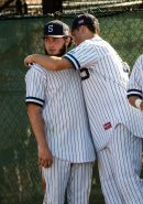 Shepaug's Cole Donaghey #12 right consoles his teammate Chance Dutcher #18, after Shepaug got beat by Coventry 3-0 in the Class S Baseball Championship game at Palmer Field in Middletown on Saturday. Bill Shettle Republican-American