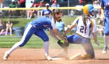 #21 Morgan Teodosio of Seymour High slides into 2nd safe as #4 Gina McKittrick of Waterford gets the late throw during CIAC Class M final in West Haven Saturday. Steven Valenti Republican-American