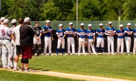 Players from the Wolcott Storm, right, and South Troy (NY) Dodgers, line up for the National Anthem during their Mickey Mantle World Series game Thursday at Municipal Stadium in Waterbury. Jim Shannon Republican-American