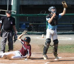 #23 Cody Colon of the Overlook Blacksox slides in safe at home as #19 Blake Salamon of the Michigan Bulls gets the late throw in the 1st inning of the Mantle Tournament at Muzzy Field in Bristol Friday. . Steven Valenti Republican-American