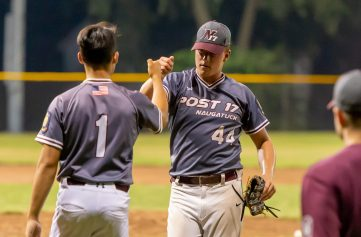 Naugatuck's pitcher Nick Delucia (44) is congratulated by teammate Tristan Bosco (1) after getting out of a jam during their American Legion baseball tournament game against Cheshire Monday at Ceppa Field in Meriden. Jim Shannon Republican-American