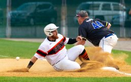 Terryville's Christian Callahan (19) gets back to first base before the tag by Blasius' Jon Conlon (44) during their Stan Musial State Tournament game with Tuesday at Municipal Stadium in Waterbury. Jim Shannon Republican-American