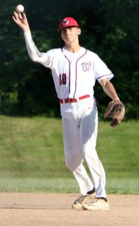 #10 Cam Maldonado of Wolcott toss the ball to first for the out against Litchfield during the Tri-State Baseball game in Litchfield Monday. Steven Valenti Republican-American