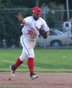Albany Athletics first baseman Caeser Matos holds off the pitcher as he makes a solo out at first base during the game against the Terryville Black Sox at Fuessenich Park on Thursday night. Emily J. Tilley. Republican-American