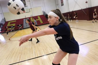 Paige Carroll of Sacred Heart warms up during volleyball practice at the school in Waterbury Thursday. Steven Valenti Republican-American