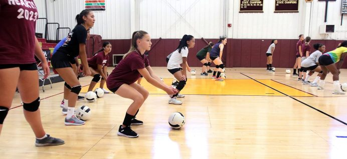 The Sacred Heart volleyball team warms up during practice at the school in Waterbury Thursday. Steven Valenti Republican-American