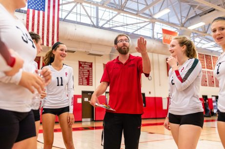 Pomperaug Girls volleyball head coach Tim Zaprzalka talks to his players in a timeout, during a girls volleyball scrimmage between Lewis Mills and Pomperaug at Pomperaug High School in Southbury on Thursday. Bill Shettle Republican-American