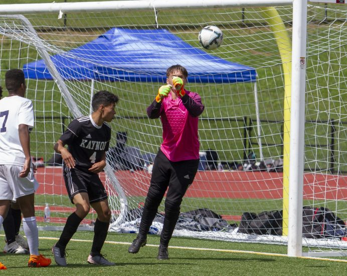 Kaynor Tech goalkeeper Jon Romano punches the ball away during a goal attempt by Kennedy during the Waterbury Soccer Jamboree Saturday morning at Crosby. Jonathan Wilcox Republican-American
