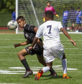 Kaynor Tech #9 Zackary Persand moves the ball past Kennedy #7 Anthony Rivera during the Waterbury Soccer Jamboree Saturday morning at Crosby. Jonathan Wilcox Republican-American