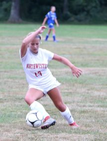 Northwestern High School's Alison Choquette kicks the ball up the field during the girls varsity soccer game against Nonnewaug High School on Thursday afternoon. Emily J. Reynolds. Republican-American