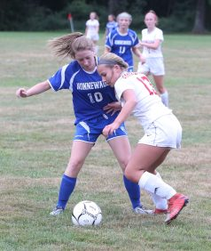 Northwestern High School's Alison Choquette battles Nonnewaug High School's Katherine Greene for the ball during the girls varsity soccer game in Hollow Park on Thursday afternoon. Emily J. Reynolds. Republican-American