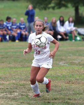 Northwestern High School's Alison Choquette knocks the ball down during the girls varsity soccer game against Nonnewaug High School in Hollow Park on Thursday afternoon. Emily J. Reynolds. Republican-American