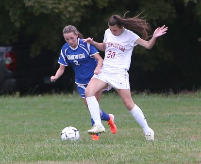 Northwestern High School's Janice Williams battles Nonnewaug High School's Alexa Burke for the ball during the girls varsity soccer game in Hollow Park on Thursday afternoon. Emily J. Reynolds. Republican-American