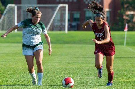 Taft's Natalie Hodak (5) and Sacred Heart-Greenwich's Amelia Sheehan (13) run down a ball during their game Wednesday at the Taft School in Watertown. Taft defeated Sacred Heart 3-1. Jim Shannon Republican-American