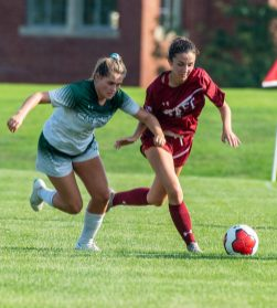 Taft's Halle Wagner (2) and Sacred Heart-Greenwich's Amelia Sheehan (13) run down the ball during their game Wednesday at the Taft School in Watertown. Taft defeated Sacred Heart 3-1. Jim Shannon Republican-American