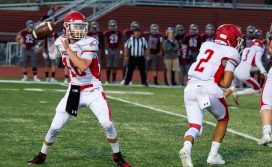 Wolcott's Matt Stoeckert (18) throws for a first down in the first half of their season opening game against Naugatuck Friday at Naugatuck High School. Jim Shannon Republican-American