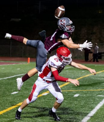 Naugatuck's Jeff Schebell (24) breaks up a pass intended for Wolcott's Kyle Hensel (25) during their season opening game Friday at Naugatuck High School. Jim Shannon Republican-American