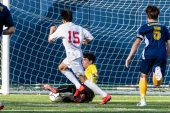 Kennedy goalkeeper Nathan Meglio comes out to make a save on Wolcott's Lisardo Tapia #15 as Kennedy's James Rusi #5 follows from behind, during a non league soccer match between Wolcott and Kennedy at Kennedy High School on Monday. Bill Shettle Republican-American