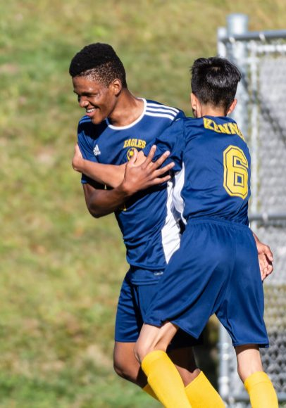 Kennedy's Kilmar Benitez- Arevalo #6 runs up to celebrate his teammate Tyreke Scarlett #7 scoring of a goal, during a non league soccer match between Wolcott and Kennedy at Kennedy High School on Monday. Bill Shettle Republican-American