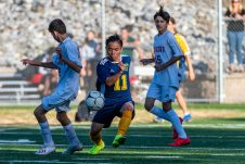 Kennedy's Sher Eh Htoo #11, controls the ball around Wolcott's Jackson Fishbein #18, with Wolcott's Lisardo Tapia #15 looking on from behind, during the a non league soccer match between Wolcott and Kennedy at Kennedy High School on Monday. Bill Shettle Republican-American
