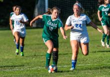 Chase's Paige Cumale #18 rushes upfield with the ball against Williams' Sydney Acheychek #24, during a soccer match between Williams and Chase Collegiate at Chase Collegiate on Wednesday. Bill Shettle Republican-American