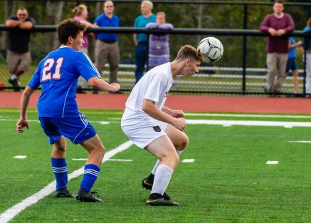 Thomaston's Ryan Bethin (4) heads the ball in front of Nonnewaug's Franco Pannofino (21) during their game Tuesday on the new turf field at Nonnewaug High School. Jim Shannon Republican-American