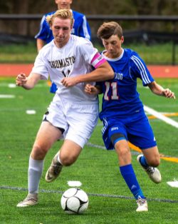 Thomaston's Ian Bethin (14) and Nonnewaug's Brendan Burke (11) battle for the ball during their game Tuesday on the new turf field at Nonnewaug High School. Jim Shannon Republican-American