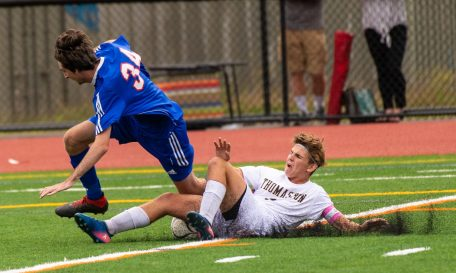 Nonnewaug's Tom Duncan (34) gets tackled by Thomaston's Chet Pierce (3) while trying to clear the ball during their game Tuesday on the new turf field at Nonnewaug High School. Jim Shannon Republican-American