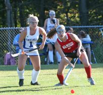 Lewis Mills High School's Sydney Minella battles Wamogo High School's #6 for the ball during the girls varsity field hockey game at Lewis Mills on Wednesday afternoon. Emily J. Tilley. Republican-American
