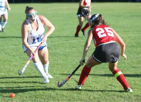 Lewis Mills High School's Emma Foley battles Wamogo High School's Rita Dziedzic for the ball during the girls varsity field hockey game at Lewis Mills on Wednesday afternoon. Emily J. Tilley. Republican-American