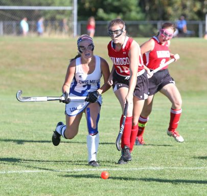 Lewis Mills High School's #2 battles Wamogo High School's #18 for the ball during the girls varsity field hockey game at Lewis Mills on Wednesday afternoon. Emily J. Tilley. Republican-American