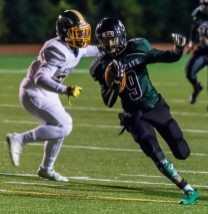 Wilby's Andres Urena (9) runs in for a touchdown after getting past Kennedy's Taeven Moshier (21)during their game Friday at Crosby High School. Jim Shannon Republican-American
