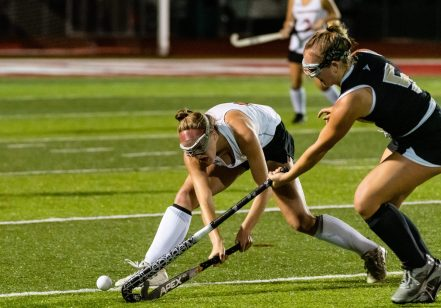 Pomperaug's Maddie MicKune (14), left, and Joel Barlow's Teagan Williams (5), battle for the ball, during a SWC girls field hockey game between Joel Barlow and Pomperaug at Pomperaug High School on Wednesday. Bill Shettle Republican-American