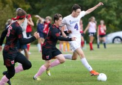 #4 Zach Thompson of Nonnewaug High controls a ball past #17 Dan Cyr of Wamogo High during soccer action in Litchfield Monday. Steven Valenti Republican-American