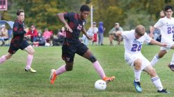 #21 Champion Boswell of Wamogo High takes a ball from #25 Josh Cheatham of Nonnewaug High during soccer action in Litchfield Monday. Steven Valenti Republican-American