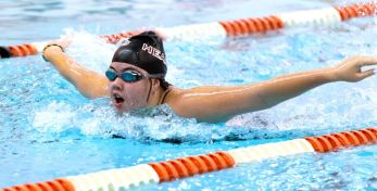 Sacred Heart's Trista Caron competes in the 100m butterfly during their NVL meet with Watertown Tuesday at Watertown High School. Jim Shannon Republican-American