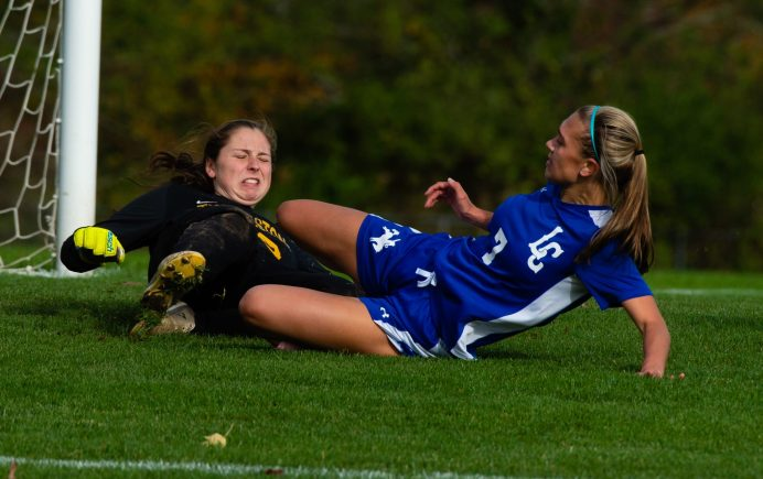 Litchfield's Christina Orsini (7) collides with Thomaston goal keeper Emily Root (98) after scoring a goal during their Berkshire League game Thursday at the Plumb Hill Playing Fields. Jim Shannon Republican-American