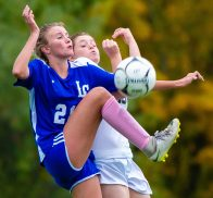 Litchfield's Camilla Seymour (21) kicks high to get control of the ball in front of Thomaston's Hannah Lawlor (13) during their Berkshire League game Thursday at the Plumb Hill Playing Fields. Jim Shannon Republican-American