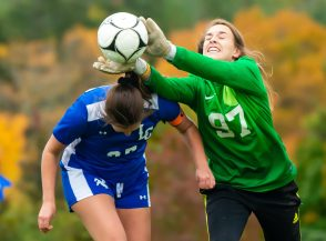 Thomaston keeper Courtney LeClair (97) makes a save as Litchfield's Allie Davenport (27) tries to head the ball in the goal during their Berkshire League game Thursday at the Plumb Hill Playing Fields. Jim Shannon Republican-American