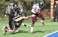 #23 Dillon Hargrove of Torrington High breaks free of #13 Josh Ross Jr. of Waterbury Career Academy for the touchdown in the 2nd quarter during football action in Waterbury Thursday. Steven Valenti Republican-American