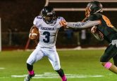 Ansonia running back Shykeem Harmon #3 runs with the ball keeping Watertown's Owen Munson (85) at arms length, during a NVL game of the unbeaten between Ansonia and Watertown at Watertown High School on Friday. Bill Shettle Republican-American