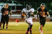 Ansonia running back Shykeem Harmon #3 runs with the ball along the sidelines past Watertown's Matthew Hardisty (69) for a easy touchdown, during a NVL game of the unbeaten between Ansonia and Watertown at Watertown High School on Friday. Bill Shettle Republican-American