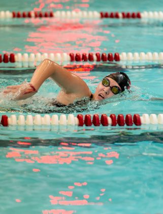 Naugatuck's Abby Shugdinis competes in the 500 Yard Freestyle during their meet with Seymour Friday at Naugatuck High School. Jim Shannon Republican-American