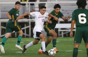 #10 Ahmed Aljamal and #2 Kevin Matiz of Holy Cross High battle for the ball during NVL Soccer action in Waterbury Monday. Steven Valenti Republican-American