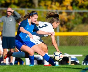 Lewis Mills' Alyse Pasqualini (18) and Newington's Karissa Zocco (3) battle for the ball during their game Tuesday at Nassahegan Field in Burlington. Jim Shannon Republican-American