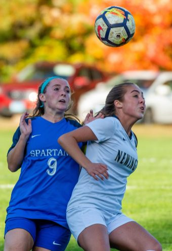 Newington's Cassidy Gilchrest (9) tries to hold off Lewis Mills' Caitlin Angers (9) while going to head the ball during their game Tuesday at Nassahegan Field in Burlington. Jim Shannon Republican-American