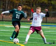 Wilby's Nilton Miguel (11) and Sacred Heart's Aidan Knappe (15) race to a loose ball during their NVL game Thursday at Municipal Stadium in Waterbury. Jim Shannon Republican-American